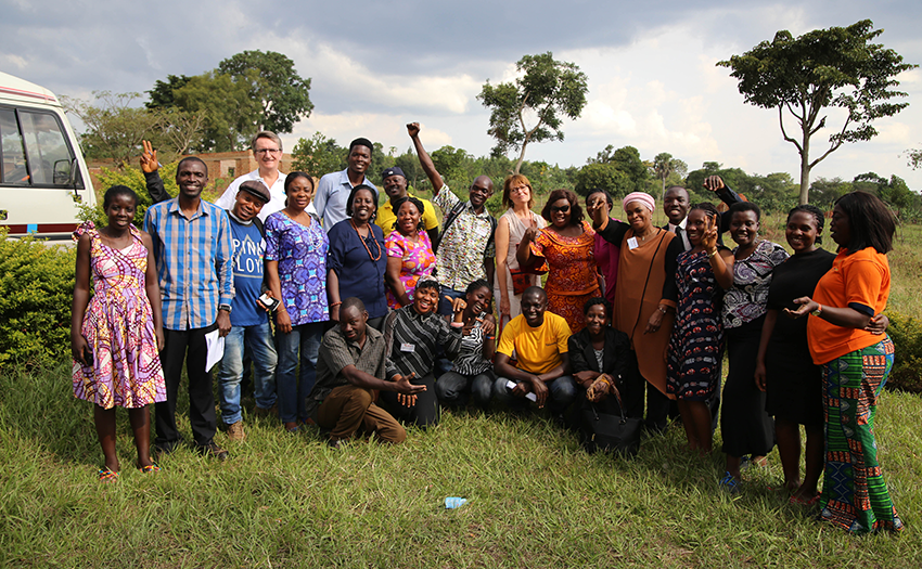 Participants pose for an lively group photo during a GREAT course